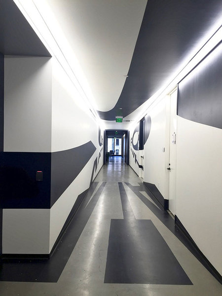 Anamorphic mural viewed from the opposite end of the corridor