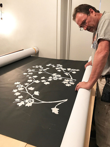 MJ Atelier unrolling our hand sculpted wallcovering